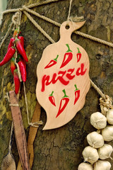 wooden board on the tree with pizza word