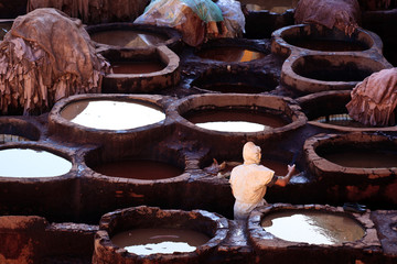 Tanning pools and workers at a traditional leather tannery