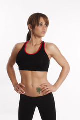 Healthy fit woman stands in her gym outfit