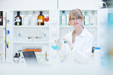 female researcher carrying out research in a lab