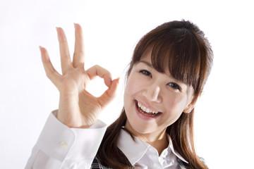 Beautiful business woman showing okay sign