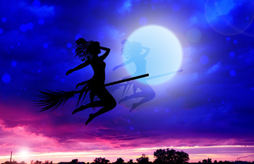 Silhouette of a witch above city