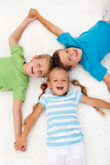 Happy laughing kids on the floor