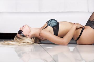 Sexy blond girl in dark lingerie