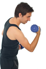 Young man working with barbell