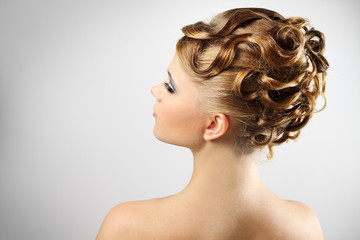 Modern wedding hairstyle. on gray