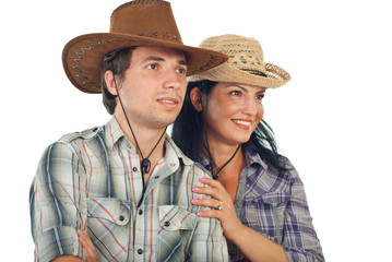 Couple with cowboy hats looking to the future