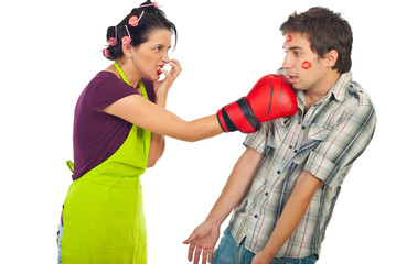 Angry housewife boxing her drunk unfaithful man