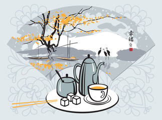 green tea with a Chinese fan with landscape