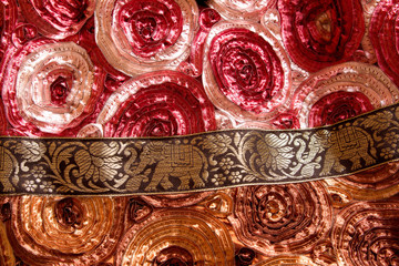 Indian silk fabric with golden elephants and flowers