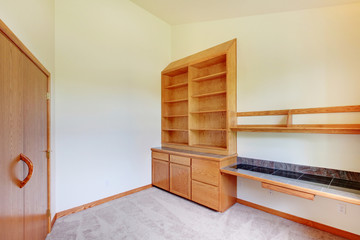Study room in a new home with build in wood cabinet