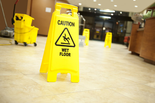 caution lobby mop bucket and sign