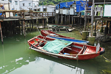 Tai O fishing village with stilt house and old boat