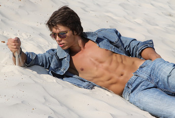 Muscle sexy wet naked young boy in jeans clothes