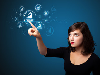 Businesswoman pressing modern business type of buttons