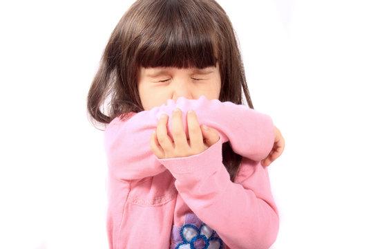 Sick child sneezing