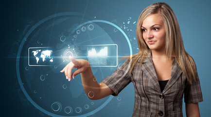 Businesswoman pressing high tech type of modern buttons