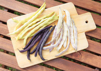 Three types of long beans - yellow, purple and yellow in the pur