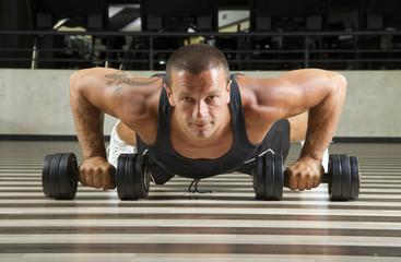 Fitness instructor doing push-ups