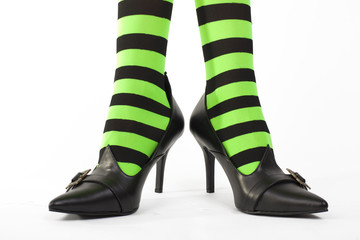Witch's striped legged stockings, white background.