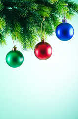 Baubles on christmas tree in celebration concept