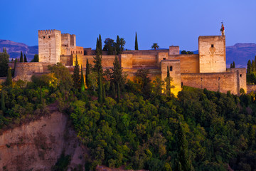 Wall Mural - Alhambra de Granada. Panoramic of the Alcazaba at dusk.