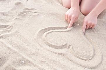 girl draws a heart