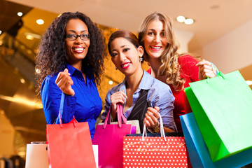 Women shopping in mall with Christmas decoration
