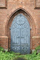 Old gothic church metal door