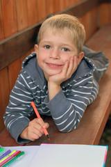 little boy with a marker pen
