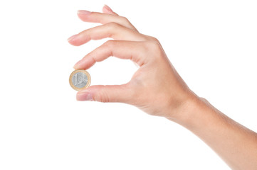 Hand holding 1 Euro coin