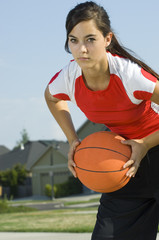 Attractive female holding a basketball