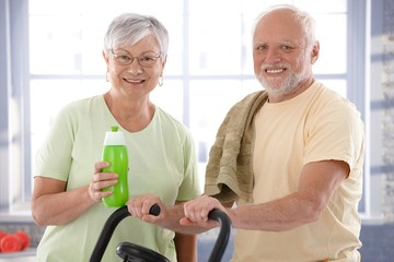 Portrait of happy senior couple in the gym