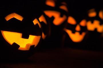 Carved Jack-o-lanterns lit for Halloween