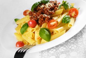 Pasta rigatoni on the white plate