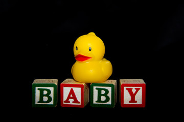 Baby and Ducky over black