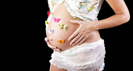 Pregnant beautiful woman with butterflies