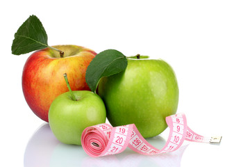 Concept of a diet. Many fresh ripe apples with measuring tape