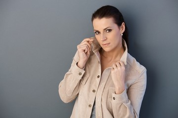 Mid-adult woman posing in spring jacket