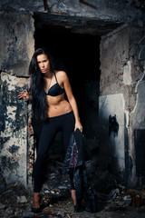 Young beautiful woman posing in ruins