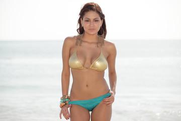 Attractive young Latina posing in a bikini