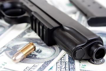 9mm bullet and handgun with money