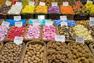 Sweets store in Boqueria Market at Ramblas in Barcelona, Spain