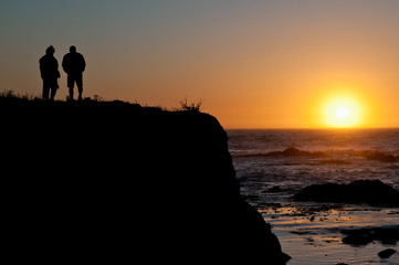Couple Silhouette at Sunset on Cliff