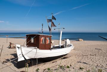 Wall Mural - Fischerboot KOS 4 am Strand von Koserow
