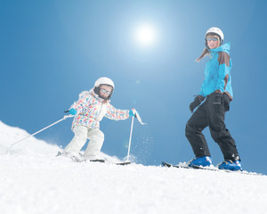 Skiing - young skiers on ski slope
