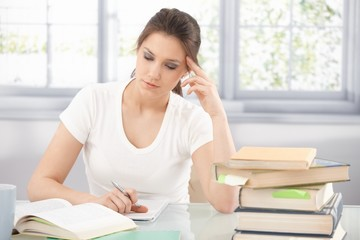 College girl learning at home thinking