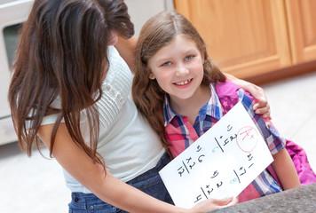 Little girl gets good grade on her homework