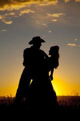 Cowboy couple silhouette dip