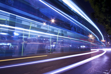 Light trails at night with busy traffic